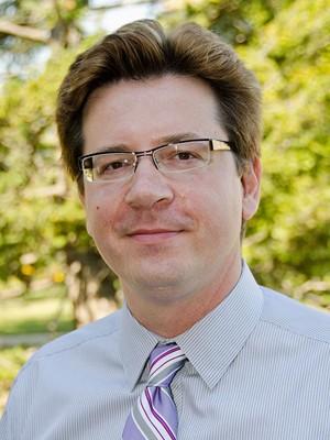 Dr. Ron Cronovich,  Professor of Economics at Carthage College.