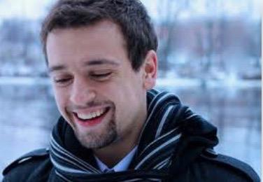 Zachary J. Moore, a choir director at Waukesha West High School