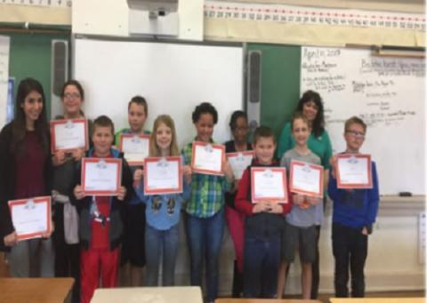 "Students pose with their newly earned ""EverFi"" Financial Training Certificates after completing training offered by Educators Credit Union"